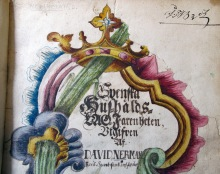Del av handmålat titelblad